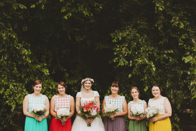 Bride with bridesmaids wearing bright pantone colored mismatched dresses