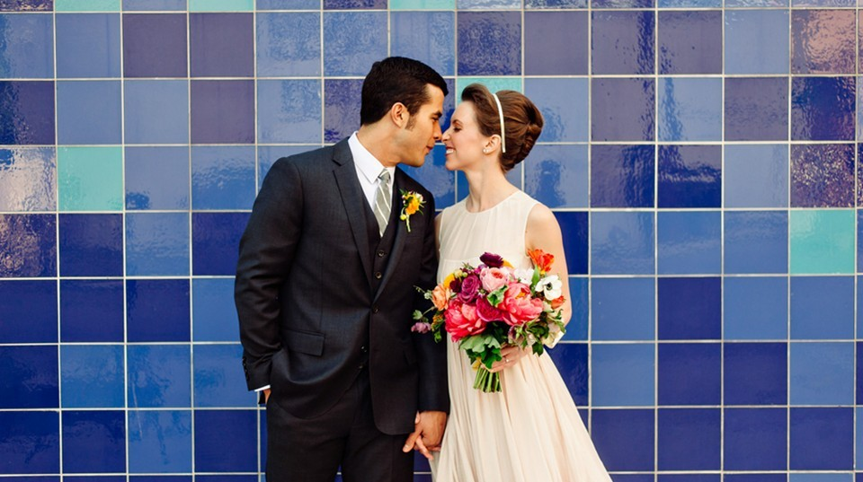 Bride and Groom standing in front of blue tiled wall in Austin Texas