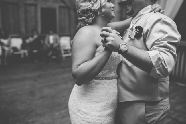 Black and white photo of bride and groom dancing at Rivercrest Farm wedding reception