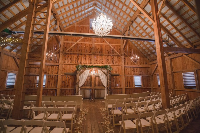 Rustic wedding ceremony venue at Rivercrest Farm with chandelier