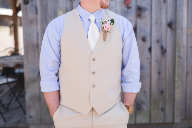 Groom wore a tan tux from men's warehouse and a light blue shirt and ivory tie.