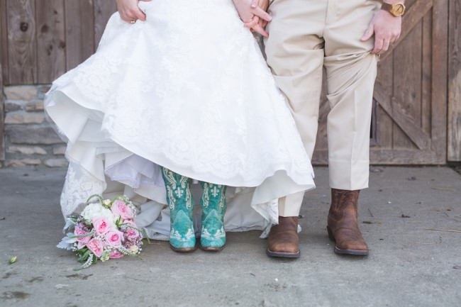 Bride wearing blue cowboy boots and groom wearing brown cowboy boots
