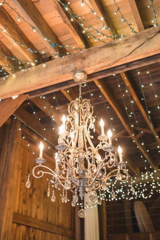 Chandelier in barn wedding reception at Rivercrest farm