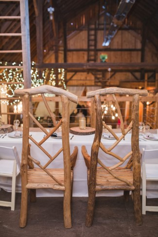 bride and groom chairs created from wood branches