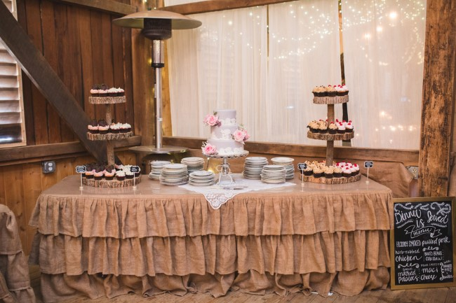 Wedding reception dessert table with mauve wedding cake and mini cup cakes