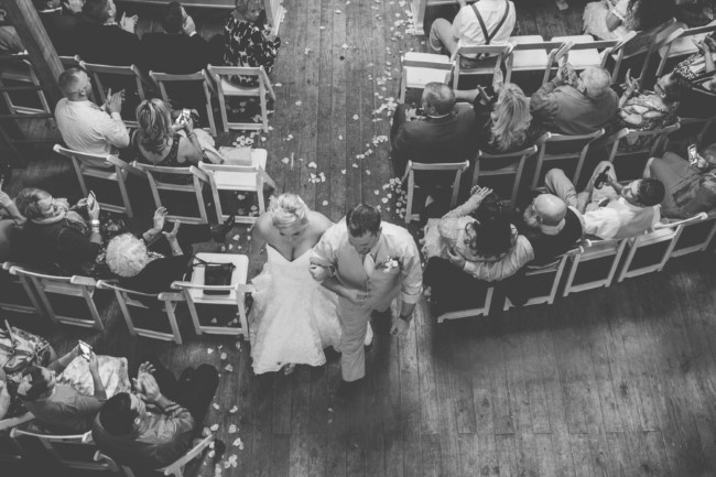 arial shot of bride and groom walking down aisle captured by KariMe Photography