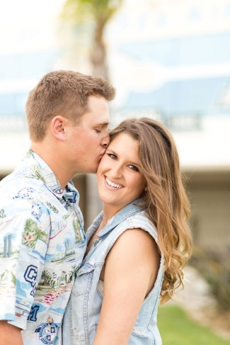 Guy kissing girls cheek in engagement session captured by Katherine Rose Photography