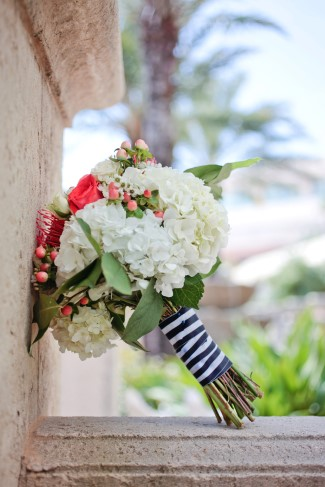 Nautical themed bridal bouquet with hydrangeas, coral roses, hypercium berries, carnations, baby's breath,