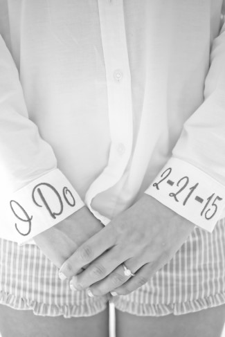 bride wearing white button down shirt with wedding date on the wrists