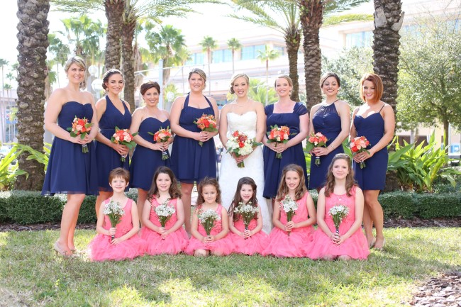 Bride standing with bridesmaid in pink and navy dresses