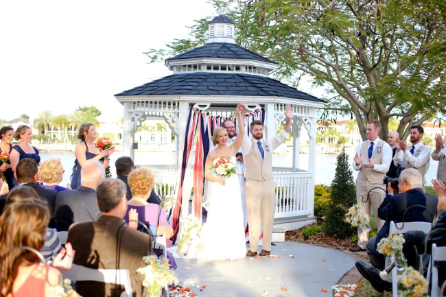 Bride and groom wedding ceremony under white gazebo at Davis Islands Garden Club
