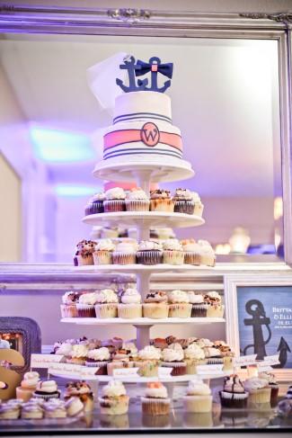 2 tier wedding cake created by Sugardarlings with cupcake tiers under neith