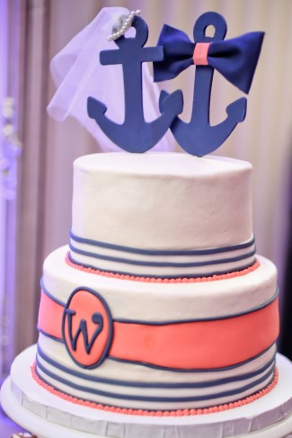 Nautical themed wedding cake created by Sugardarlings with anchor cake toppers