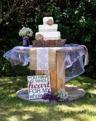 wedding cake with burlap decor and runner