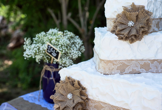 burlap DIY flowers and lace on wedding cake