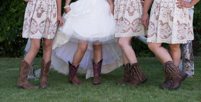 bride and bridesmaids showoff their cowboy boots