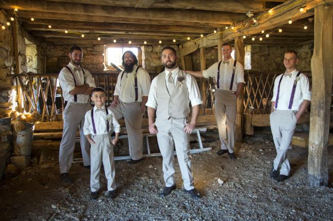 Groom with groomsmen in tan pants and suspenders