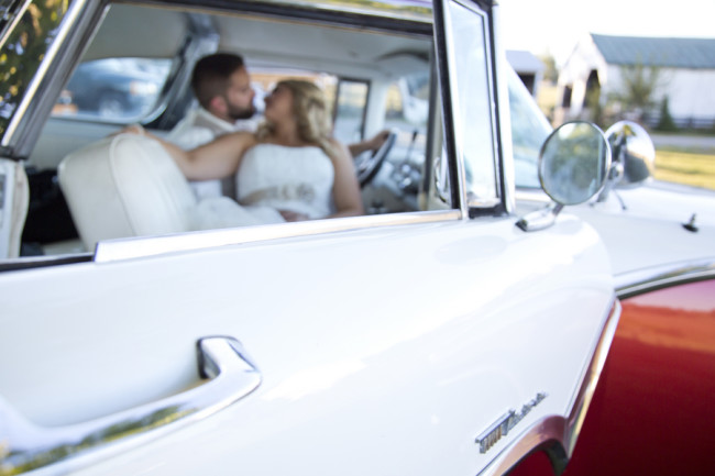 Bride and groom in a vintage car captured by Stephanie Leigh Photography & Design