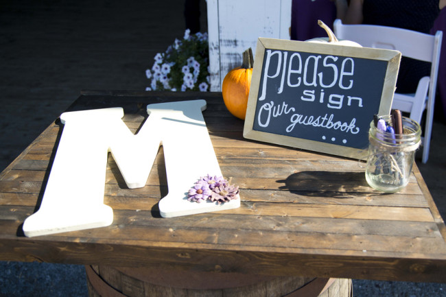Large wooden M for guests to sign as a wedding guest book