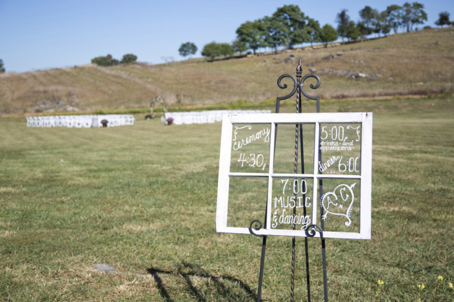 Vintage window frame with wedding day time frame written on it
