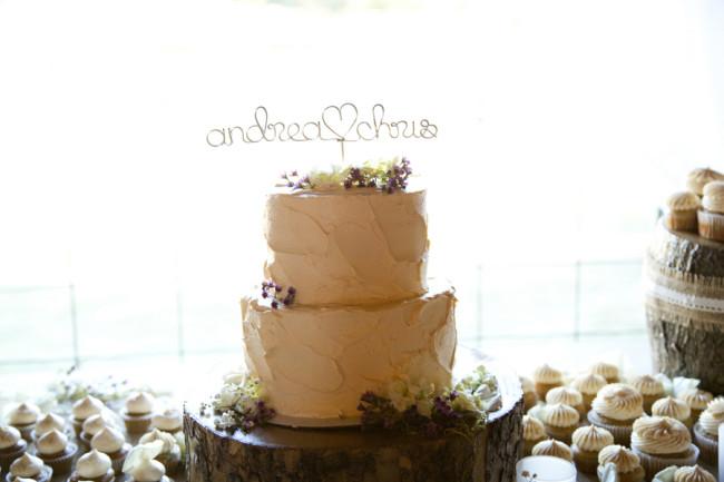 2 tier butter cream wedding cake with small purple flowers created by Shugar Shugar