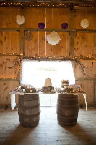 Rustic wedding dessert table. Wine barrel used for a dessert table