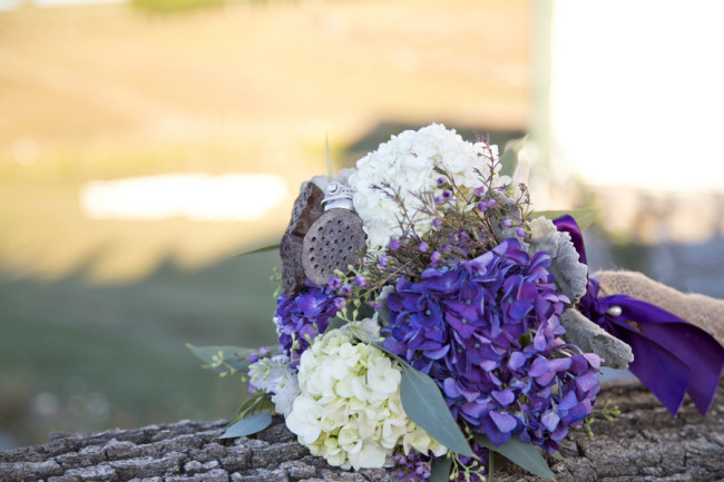 White and purple hydrangeas bridal bouquet with burlap wrapped stem