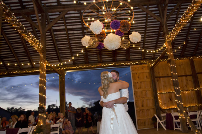 Bride and groom dancing during rustic wedding ceremony captured by Stephanie Leigh Photography & Design