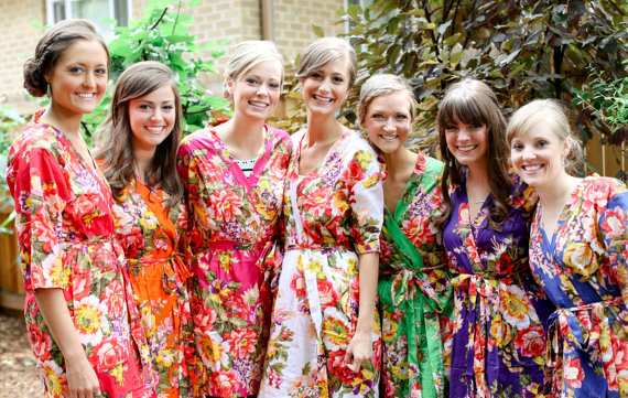 Bride with her bridesmaids wearing floral print robes