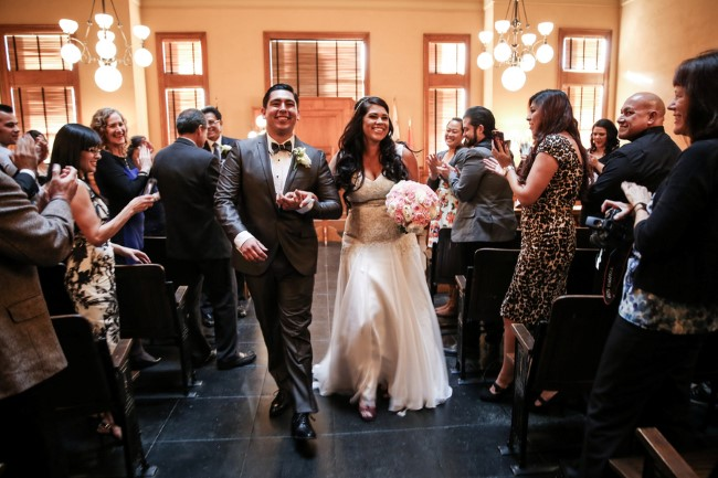 Bride and groom walking down the aisle at Orange County Courthouse captured by OANA FOTO
