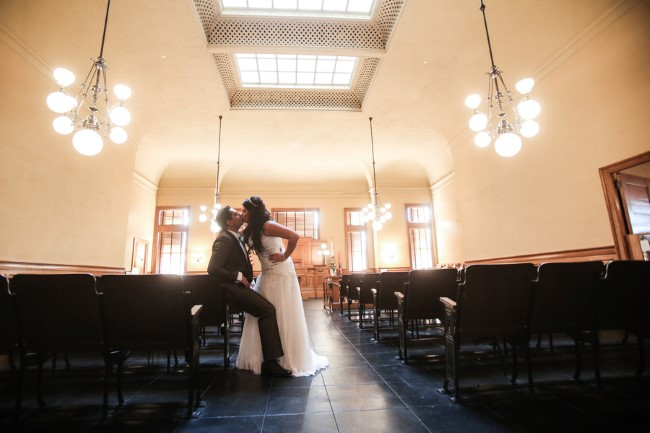 Bride and groom kissing after wedding ceremony at Orange County Courthouse
