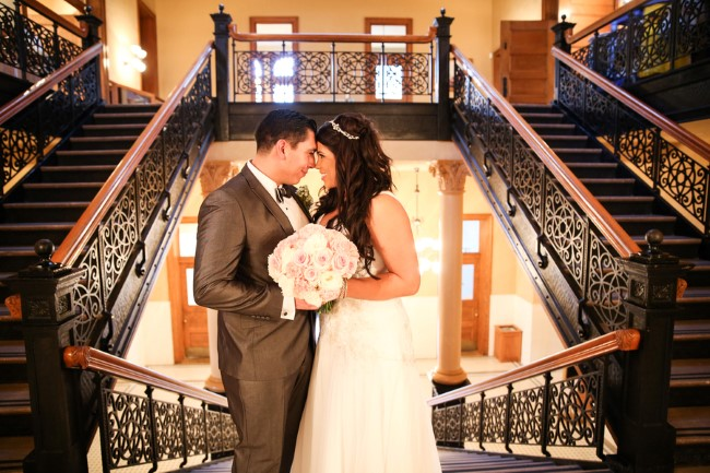 bride and groom standing at the top of the stairs at Orange County Courthouse