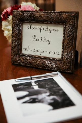Wedding guest book with a frame that tells guest how to sign their guest book