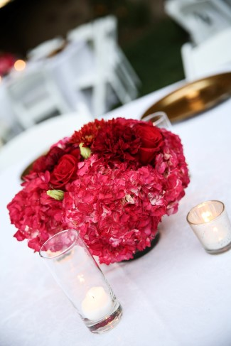 Red wedding reception center piece created by Oceanic Flowers