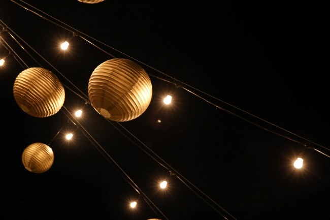 Wedding reception with gold lanterns and lights at night
