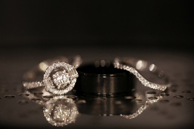 Round diamond engagement ring with halo and baguettes