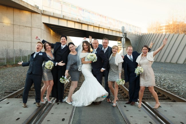 Bridal party posing on Seattle railroad track