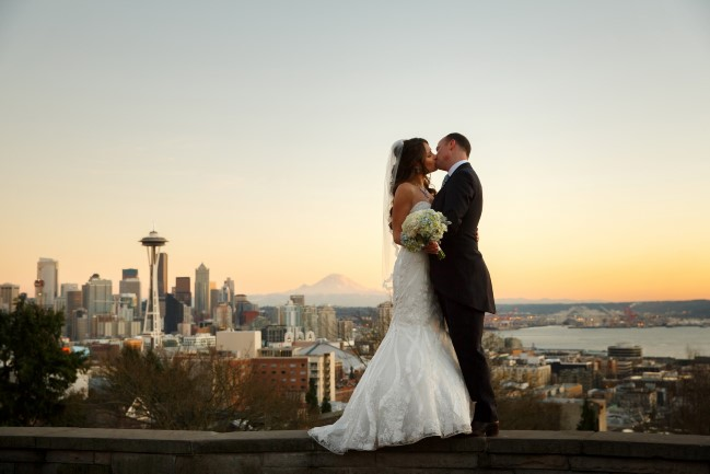 Couple kissing with Seattle skyline in the background