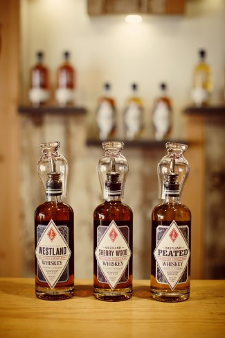 Bottles of Westland Distillery whiskey at the bar