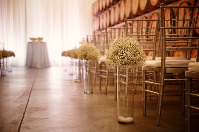 baby's breath aisle decor in barrel room