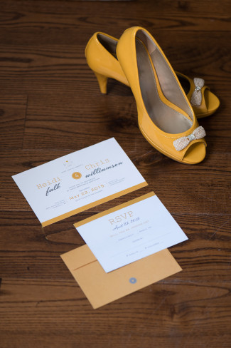 Yellow wedding shoes with yellow and grey wedding invitations from Vista print