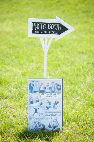 Chalkboard arrow pointing to photo booth