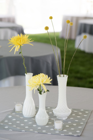 Yellow spider mums and billy balls in milk glass vases for yellow and grey wedding reception
