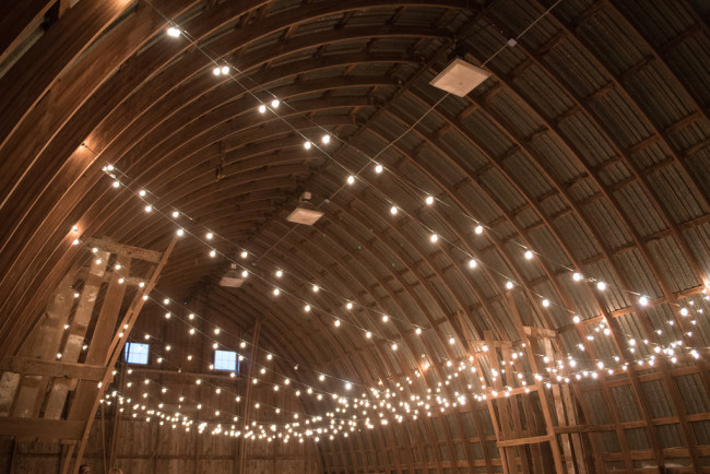 Barn wedding with mini lights streamed back and forth
