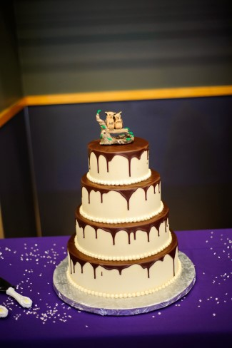 4 tier white wedding cake with chocolate sauce dripping from each tier