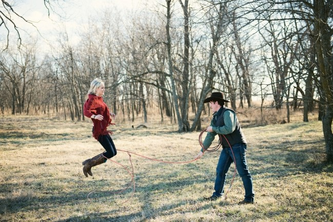 Engagement shoot with guy trying to lasso his fiance