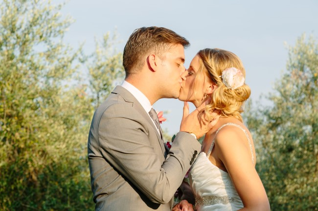 Bride and groom kissing after wedding ceremony captured by Innocenti Studio