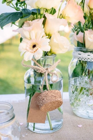 Cream gerber daisy in clear vase with cork for wedding reception floral center piece