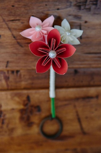 Bright colored paper flower boutonniere