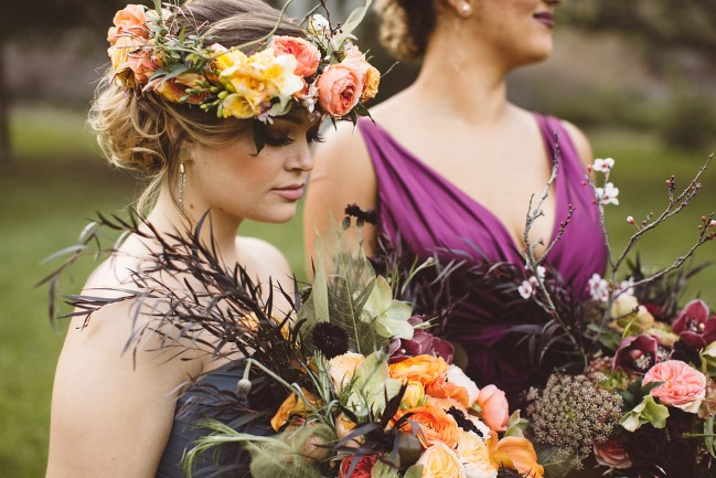 models wearing flower crowns hold rustic styled shoot bouquets
